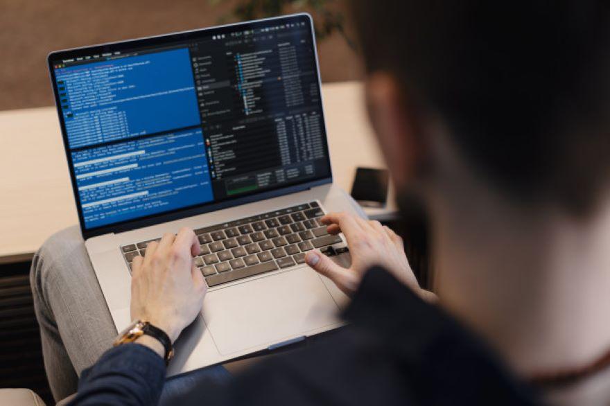 man writing code